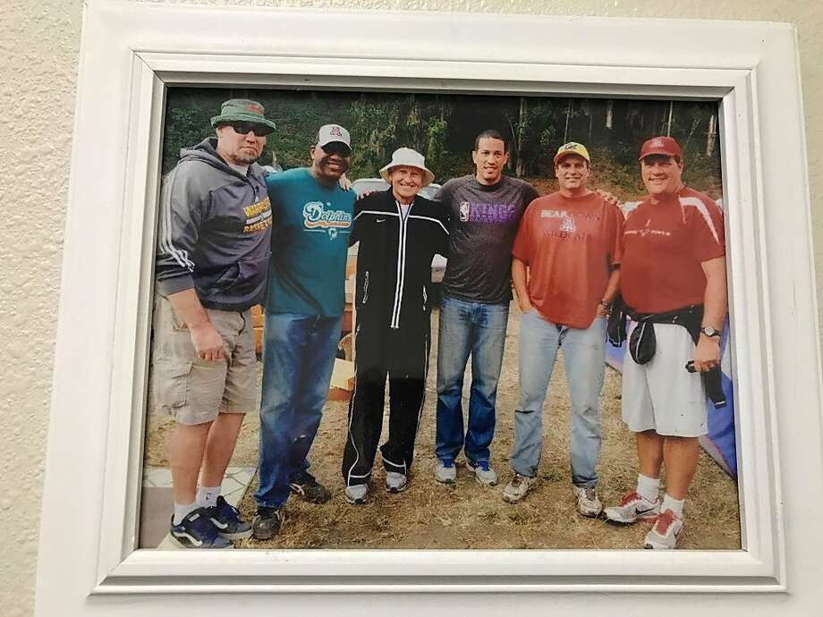Craig McMillan takes an annual fishing trip to Albion with several friends from the University of Arizona. This photo hangs on the wall in McMillan's office at Santa Rosa Junior College. Left to right: Tom Tolbert, Joe Turner, former Arizona coach Lute Olson, Bennett Davison, McMillan and Craig Bergman. Photo: Photo By Ron Kroichick