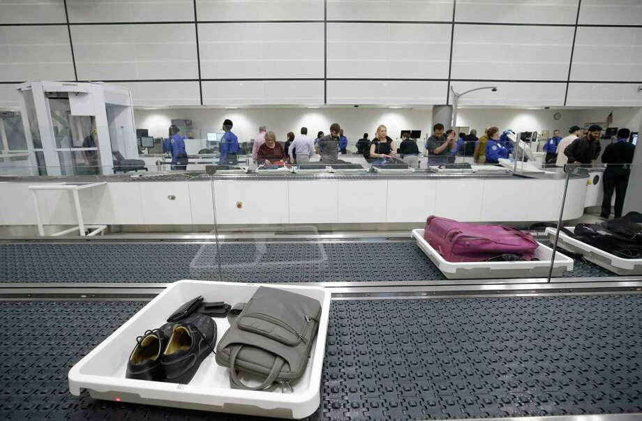 Luggage and other items is shown on an automated security lane system for departing passengers at a TSA security checkpoint. Photo: Melissa Phillip, Houston Chronicle / © 2018 Houston Chronicle