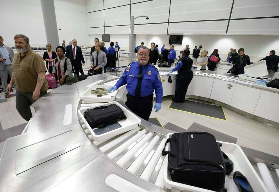 United Airlines will demonstrate its new automated security lanes for international travelers with connecting flights at Bush Intercontinental Airport on Thursday, June 28, 2018. Pictured are the automated security lanes installed by the Houston Airport System earlier this year in Terminal D.  Photo: Melissa Phillip, Houston Chronicle / © 2018 Houston Chronicle