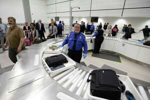 TSA officials demonstrate an automated security lane system for departing passengers at the TSA security checkpoint in Terminal D at Bush Intercontinental Airport Thursday, Feb. 15, 2018, in Houston.