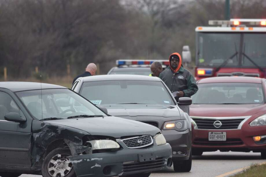 A crash on Wurzbach Parkway on Thursday involved at least five vehicles and a downed light pole. Photo: Caleb Downs /San Antonio Express-News / San Antonio Express-News
