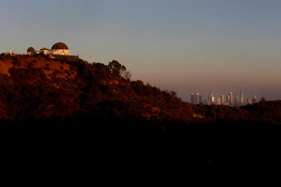 The Griffith Park Observatory (left) and the downtown L.A. skyline are hazy with smog in August 2016. Researchers blame fragrances for much of the smog. Photo: Francine Orr, TNS