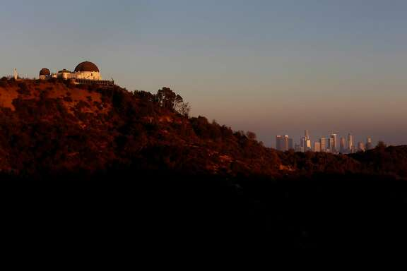 The Griffith Park Observatory and downtown Los Angeles hazy with smog on Aug. 10, 2016.   (Francine Orr/ Los Angeles Times/TNS)