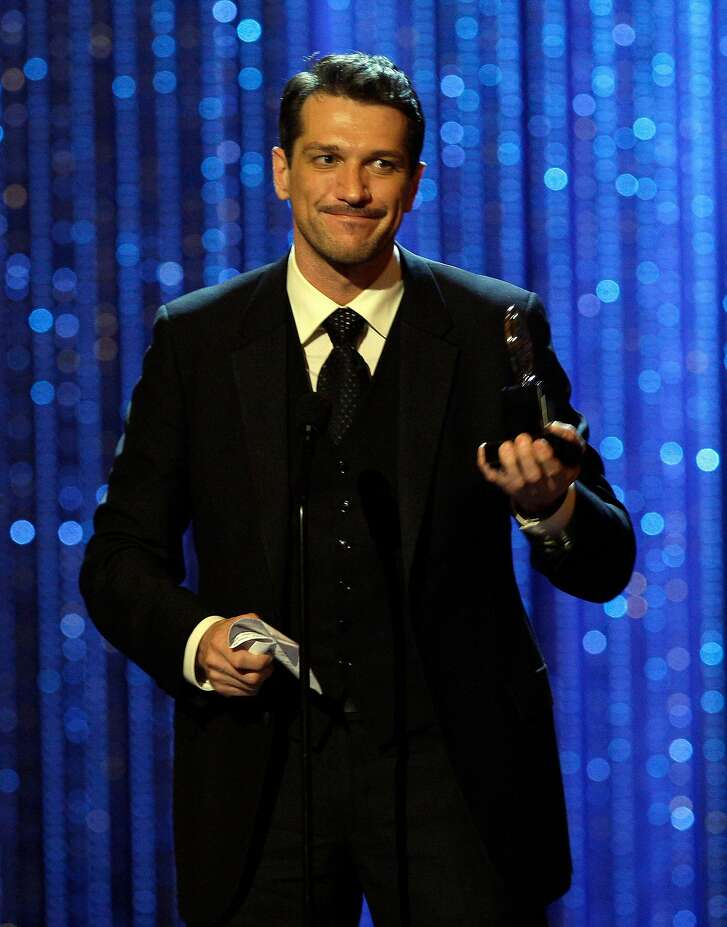 "Actor Paulo Szot accepts his award for best performance by a leading actor in a musical for his work in ""South Pacific,"" during the 62nd Annual Tony Awards in New York, Sunday, June 15, 2008. (AP Photo/Jeff Christensen)"