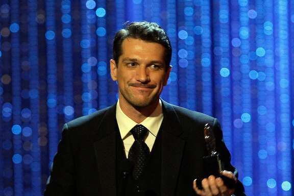 """Actor Paulo Szot accepts his award for best performance by a leading actor in a musical for his work in """"South Pacific,"""" during the 62nd Annual Tony Awards in New York, Sunday, June 15, 2008. (AP Photo/Jeff Christensen)"""