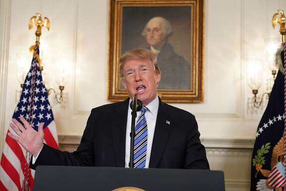 """TOPSHOT - US President Donald Trump speaks on the Florida school shooting, in the Diplomatic Reception Room of the White House on February 15, 2018 in Washington, DC. Earlier Thursday, President Trump issued a largely symbolic proclamation, ordering that flags be flown at half staff at US embassies, government buildings and military installations.""""Our nation grieves with those who have lost loved ones in the shooting at the Marjory Stoneman Douglas High School in Parkland, Florida,"""" he said.  / AFP PHOTO / Mandel NGANMANDEL NGAN/AFP/Getty Images"""