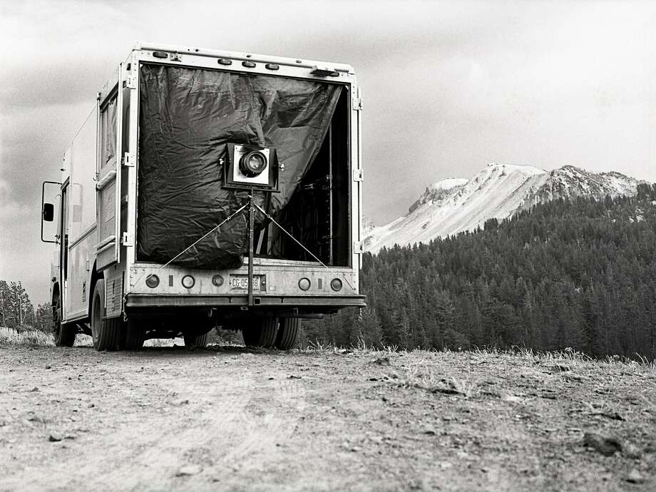 """Ian Ruhter uses a camera truck, pictured here in the Sierra Nevada Mountains, to make large-scale images on glass and aluminum sheets. Ruhter's work is on view in """"Perfect Imperfections"""" at Art Ventures Gallery in Melo Park through March 14. Photo: Elias Sidney Blood Photo: Ian Ruhter"""