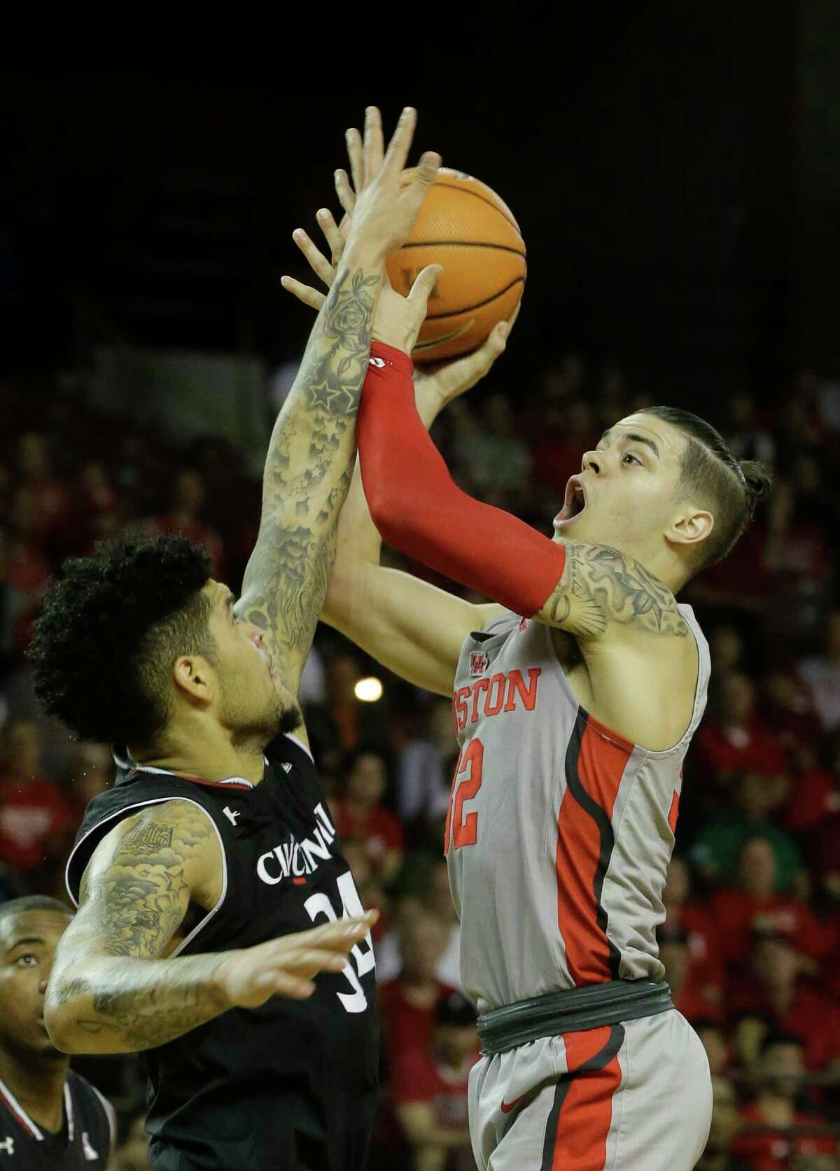 University of Cincinnati Jarron Cumberland, left, looks to block the shot of University of Houston Rob Gray during the first half of game at Texas Southern University Thursday, Feb. 15, 2018, in Houston.