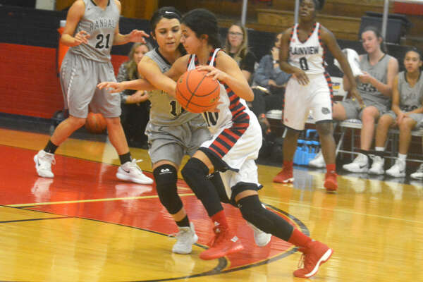 Plainview point guard Kristan Rincon tries to dribble past a defender in a game earlier this season. Guard play will be pivotal in the area round playoff game against El Paso Andress.