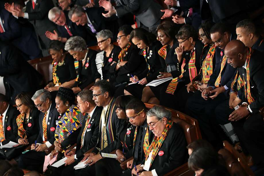 Members of Congress wear black clothing and Kente cloth in protest before the State of the Union address in the chamber of the U.S. House of Representatives January 30, 2018 in Washington, DC. Photo: Mark Wilson, Getty Images