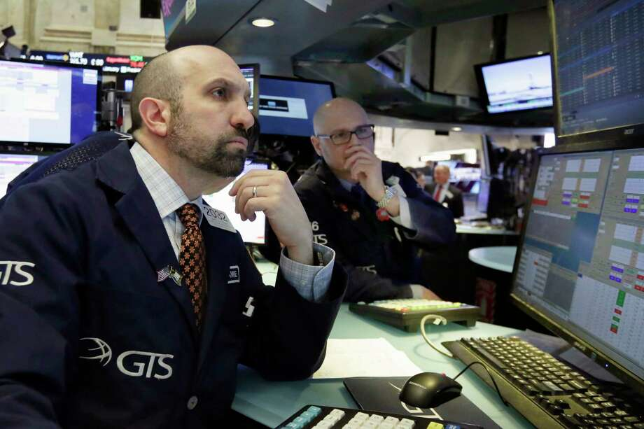 Specialists James Denaro, left, and Mario Picone work at their post on the floor of the New York Stock Exchange, Thursday, Feb. 15, 2018. Stocks are opening higher on Wall Street after several U.S. companies reported solid results. (AP Photo/Richard Drew) Photo: Richard Drew, STF / AP