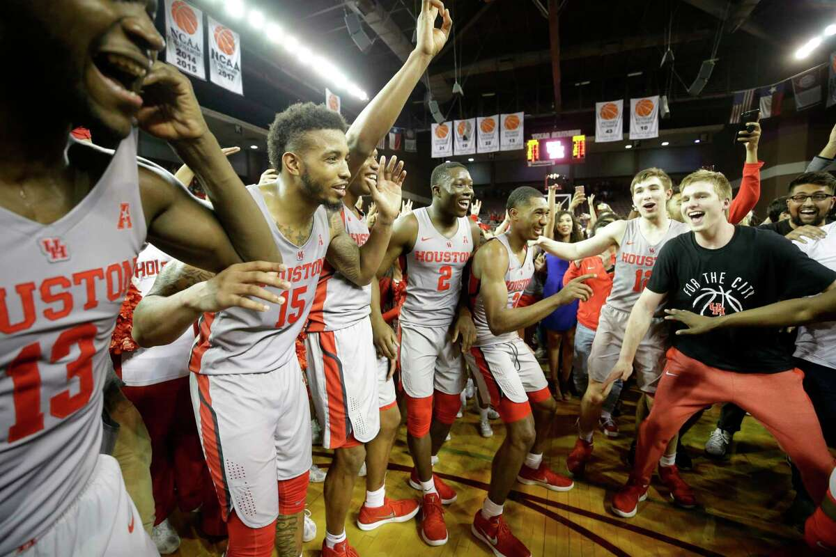 PHOTOS: A look at UH's big upset win over No. 5 Cincinnati University of Houston players celebrate with fans after victory over the University of Cincinnati at Texas Southern University Thursday, Feb. 15, 2018, in Houston.
