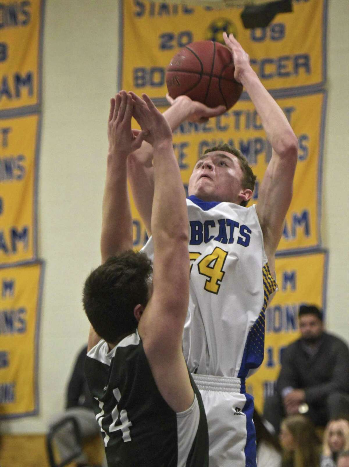 Brookfield's Christopher Pesantez (44) shoots over New Milford's Christopher Pesantez (44) in the boys basketball game between New Milford and Brookfield high school, Thursday night, February 15, 2018, at Brookfield High School, Brookfield, Conn.