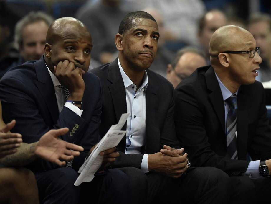 UConn head coach Kevin Ollie, center, watches with assistant coach Dwayne Killings, left, and associate head coach Raphael Chillious against Tulsa Thursday in Hartford. Photo: Jessica Hill / Associated Press / AP2018