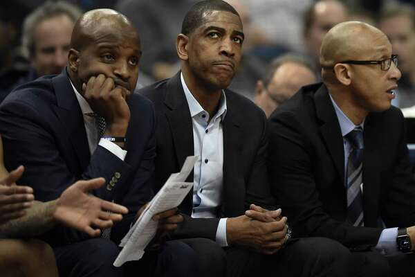 UConn head coach Kevin Ollie, center, watches with assistant coach Dwayne Killings, left, and associate head coach Raphael Chillious against Tulsa Thursday in Hartford.
