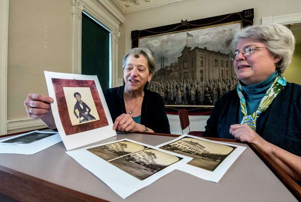 Rensselaer County and Troy City Historian Kathy Sheehan, left, and Stacy Pomeroy Draper, curator, look over a photo of the artwork they are trying to purchase of Peter F. Baltimore, father of Garnet Douglass Baltimore, first African American graduate of RPI and city engineer on Wednesday Feb. 14, 2018, in Troy, N.Y. (Skip Dickstein/Times Union) Wednesday Feb. 14, 2018 at the Rensselaer County Historical Society in Troy, N.Y. (Skip Dickstein/Times Union)