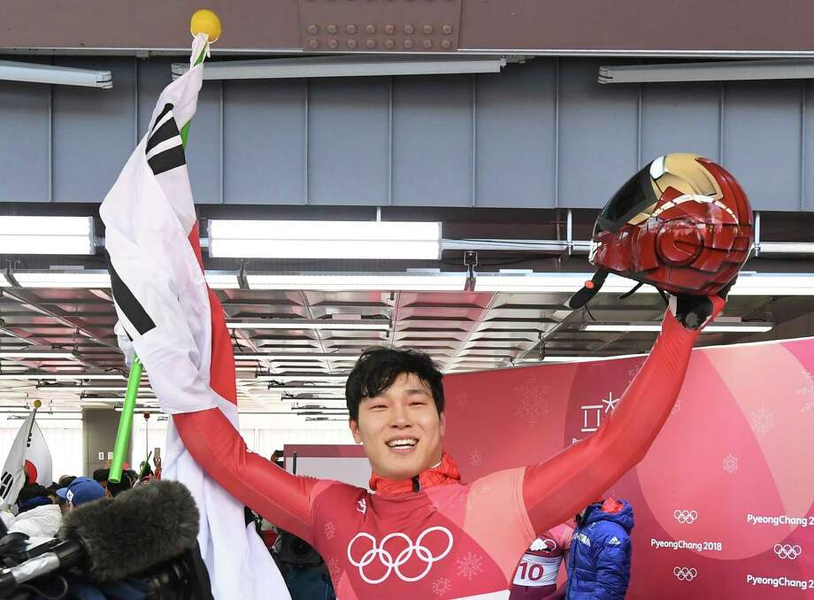 South Korea's Yun Sungbin celebrates getting the gold in the mens's skeleton heat 4 final run during the Pyeongchang 2018 Winter Olympic Games, at the Olympic Sliding Centre on February 16, 2018 in Pyeongchang.  / AFP PHOTO / Mark RALSTONMARK RALSTON/AFP/Getty Images Photo: MARK RALSTON, AFP/Getty Images / AFP