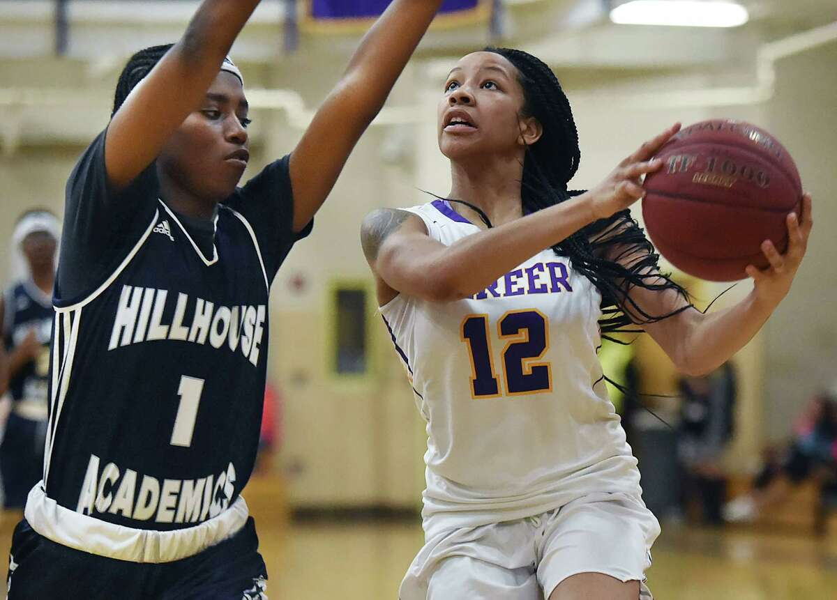Career's Ciara Little eyes the basket as Hillhouse's Keyshan Moore defends in a SCC tournament opener, Wednesday, Feb. 15, 2018, at the Hill Regional Career High School in New Haven. Career beat Hillhouse, 60-51.