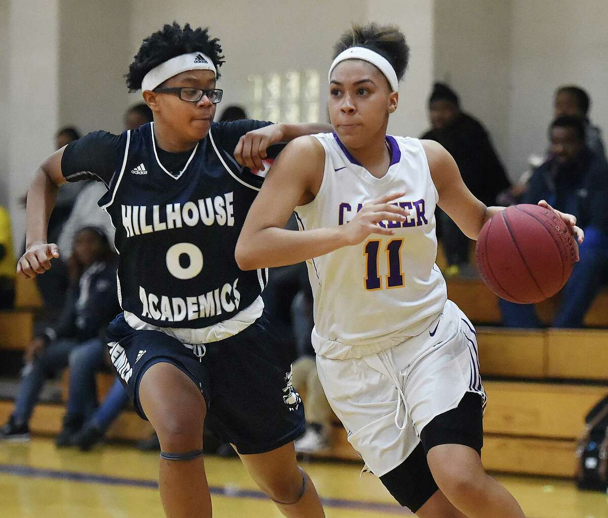 Career's Kyla Franklin drives past Tyree Allen of Hillhouse in a SCC tournament opener, Wednesday, Feb. 15, 2018, at the Hill Regional Career High School in New Haven. Career won, , 60-51.
