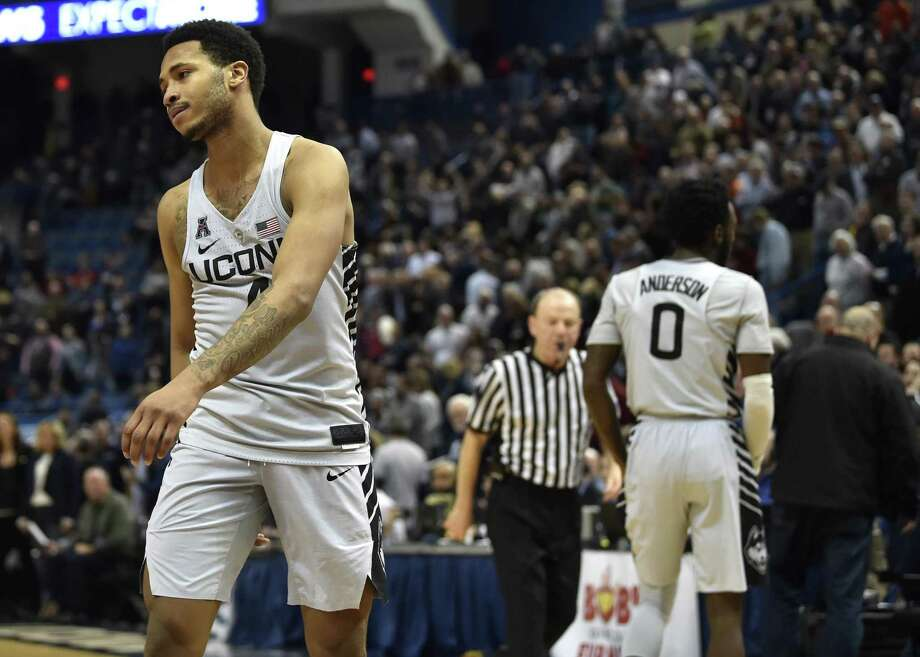 Connecticut's Jalen Adams, left, walks off the court after a 73-71 loss against Tulsa at XL Center in Hartford, Conn., on Thursday, Feb. 15, 2018. (Brad Horrigan/Hartford Courant/TNS) Photo: Brad Horrigan / TNS / Hartford Courant