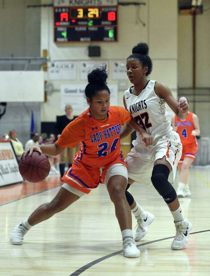 Danbury Ty'Lynn Ith (24) drives on Stamford Brooke Kelly (32) during an FCIAC girls basketball game at Stamford High School in Stamford, Conn. on Tuesday, Jan. 30, 2018. Photo: Matthew Brown / Hearst Connecticut Media / Stamford Advocate