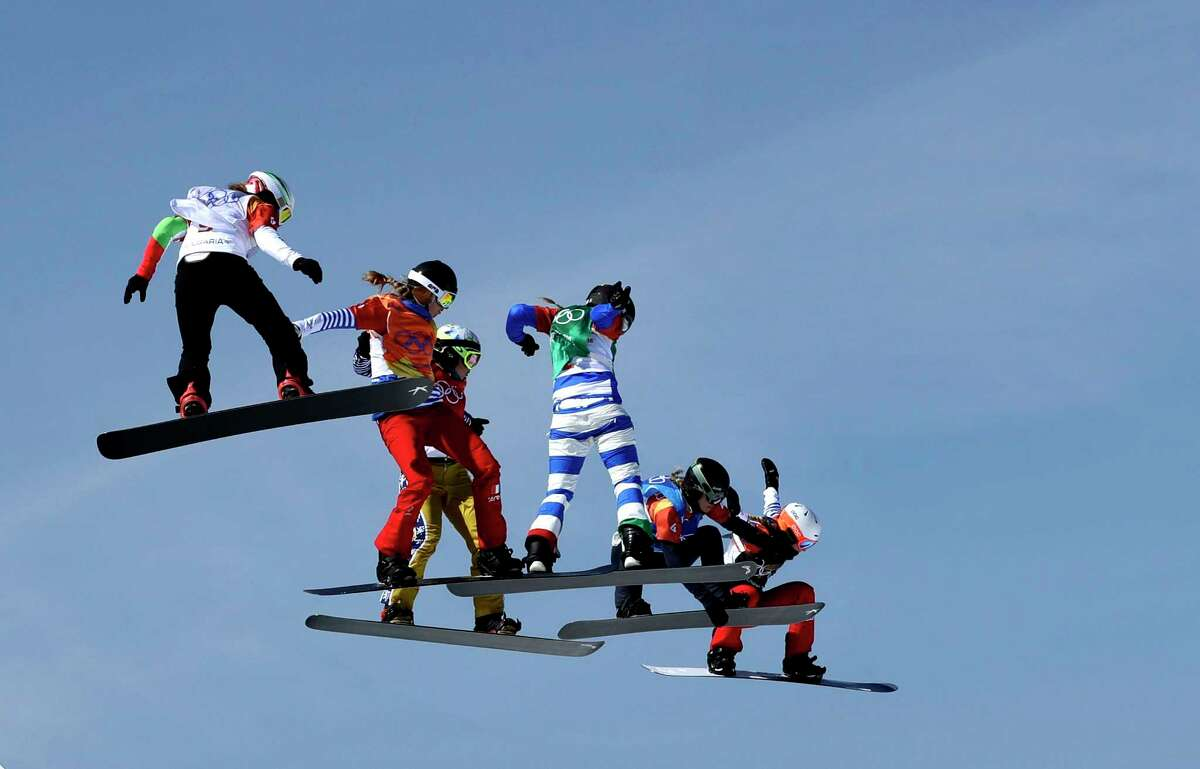 From left; AlexandraJekova, of Bulgaria, ChloeTrespeuch, of France, EvaSamkova, of the Czech Republic, MichelaMoioli, of Italy, LindseyJacobellis, of the United States, and De Sousa Mabileau JuliaPereira, of France, run the course during the women's snowboard cross finals at Phoenix Snow Park at the 2018 Winter Olympics in Pyeongchang, South Korea, Friday, Feb. 16, 2018.