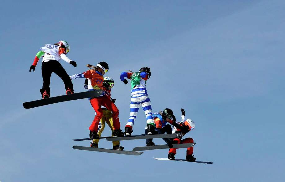 From left; Alexandra Jekova, of Bulgaria, Chloe Trespeuch, of France, Eva Samkova, of the Czech Republic, Michela Moioli, of Italy, Lindsey Jacobellis, of the United States, and De Sousa Mabileau Julia Pereira, of France, run the course during the women's snowboard cross finals at Phoenix Snow Park at the 2018 Winter Olympics in Pyeongchang, South Korea, Friday, Feb. 16, 2018. Photo: Gregory Bull, AP / Copyright 2018 The Associated Press. All rights reserved