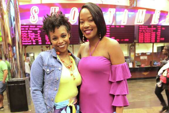 Kisha Lewis, right, and Alesha Christmas pose for a photo while waiting in line to watch Black Panther at Edwards Theater Greenway Plaza on Thursday, Feb. 15, 2018, in Houston.