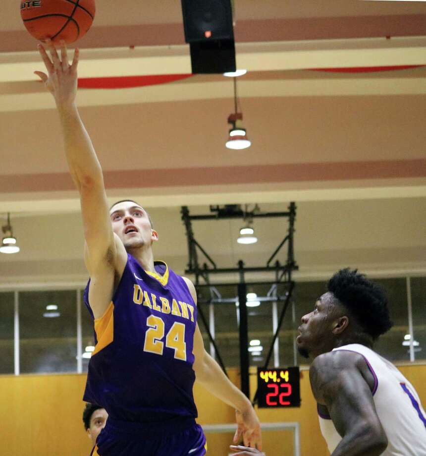 UAlbany forward Joe Cremo completes a layup over UMass-Lowell guard Rinardo Perry during their game on Thursday, Feb. 15, 2018. (George DeLuca / Special to the Times Union)