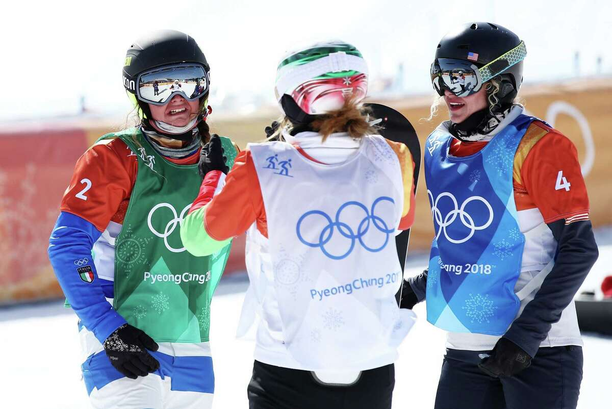 PYEONGCHANG-GUN, SOUTH KOREA - FEBRUARY 16: Michela Moioli of Italy (green) celebrates winning gold with Alexandra Jekova of Bulgaria (white) and Lindsey Jacobellis of the United States (blue) during the Ladies' Snowboard Cross Big Final on day seven of the PyeongChang 2018 Winter Olympic Games at Phoenix Snow Park on February 16, 2018 in Pyeongchang-gun, South Korea. (Photo by Cameron Spencer/Getty Images)