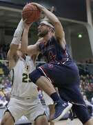 Saint Mary's forward Calvin Hermanson (24) drives against San Francisco guard Jordan Ratinho during the first half of an NCAA college basketball game in San Francisco, Thursday, Feb. 15, 2018. (AP Photo/Jeff Chiu)