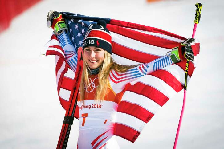 Mikaela Shiffrin of the U.S. celebrates after winning gold in the women's giant slalom in Pyeongchang, South Korea, on Thurs., Feb. 15, 2018. After three days of races postponed by strong winds, Shiffrin's celebrated quest for multiple gold medals at the Pyeongchang Olympics finally began. (Doug Mills/The New York Times)