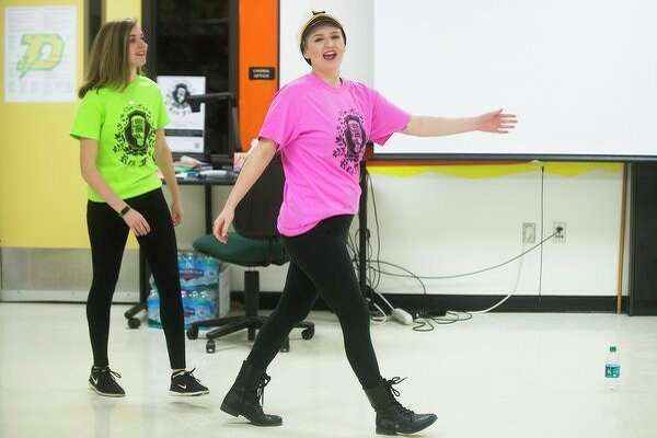 Dow High seniors Lillian Baker, left, and Jessica Brooks rehearse skits on Wednesday that they will perform as they host Ren Fair, Dow High's annual talent showcase. (Katy Kildee/kkildee@mdn.net)