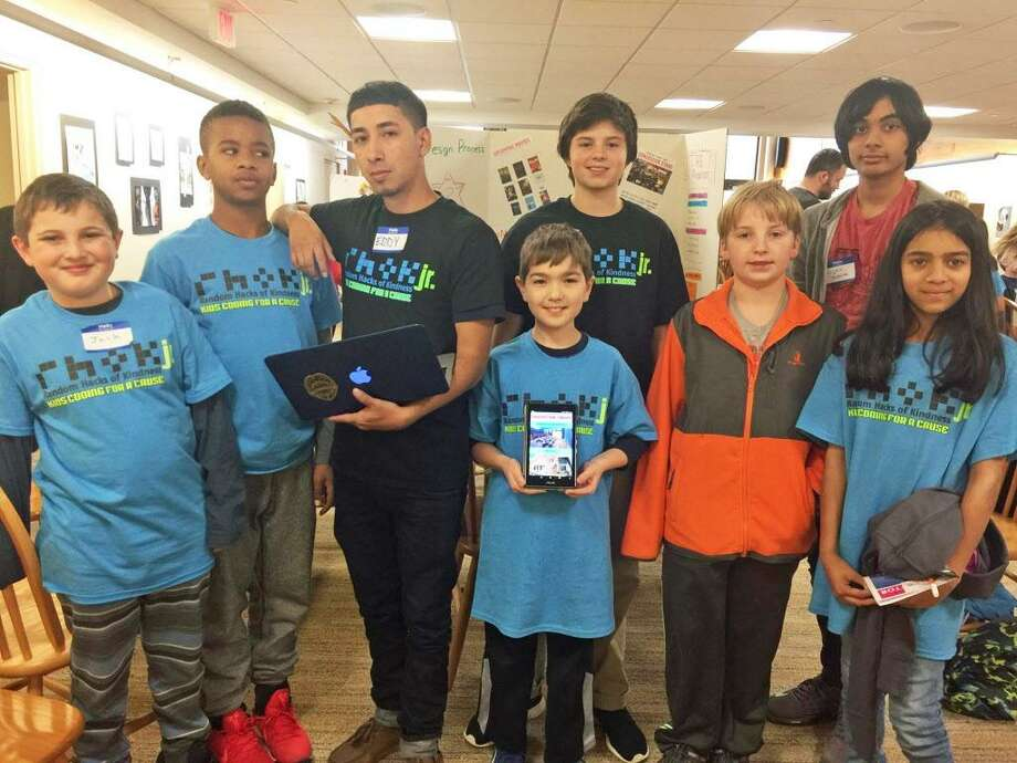 Students attend the Dec. 2, 2017, Random Hacks of Kindness hackathon at St. Luke's School in New Canaan, showing off their completed app for the Prospector Theater from Ridgefield. Photo: Contributed Photo