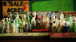 Bottles with messages found in riverbeds and waterways throughout the nation are on display at the Houston Museum of Natural Science.