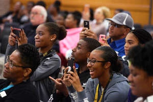Audience members react to the announcement during the Beaumont ISD meeting to discuss the new high school's name, colors and mascot on Thursday night. Students from Ozen and Central chose Beaumont United High School Timberwolves with maroon and gold colors.  Photo taken Thursday 2/15/18 Ryan Pelham/The Enterprise