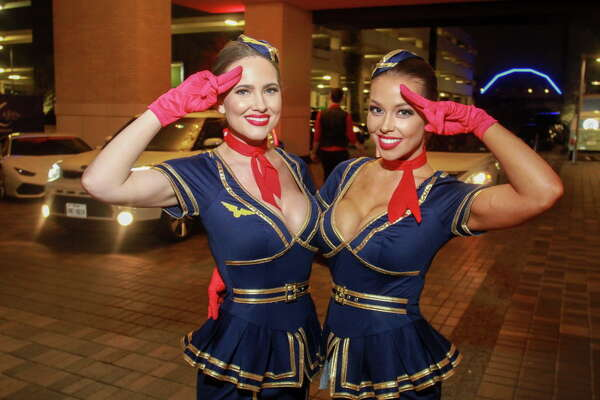 Lindsey Bonin, left, and Sarah Leeann Pressler, dressed as stewardesses, welcome guests to the Hotel ZaZa Memorial City VIP Opening Party.