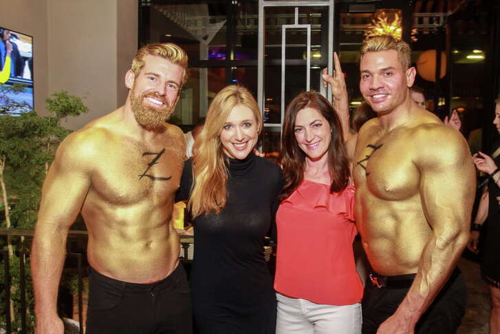 Katherine Deffebach, left, and Anita Ramke with the Gold Men, at the Hotel ZaZa Memorial City VIP Opening Party.