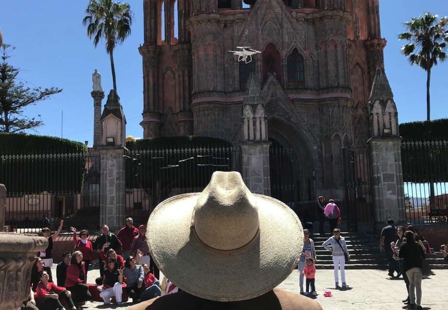 A drone owner maneuvers his quadcopter over a crowd in the town square of San Miguel de Allende, Mexico. (Dwight Silverman / Houston Chronicle) Photo: Dwight Silverman, Houston Chronicle