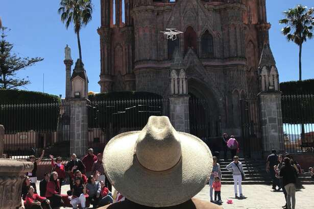 A drone owner maneuvers his quadcopter over a crowd in the El Jardin town square in San Miguel de Allende, Mexico. (Dwight Silverman / Houston Chronicle)