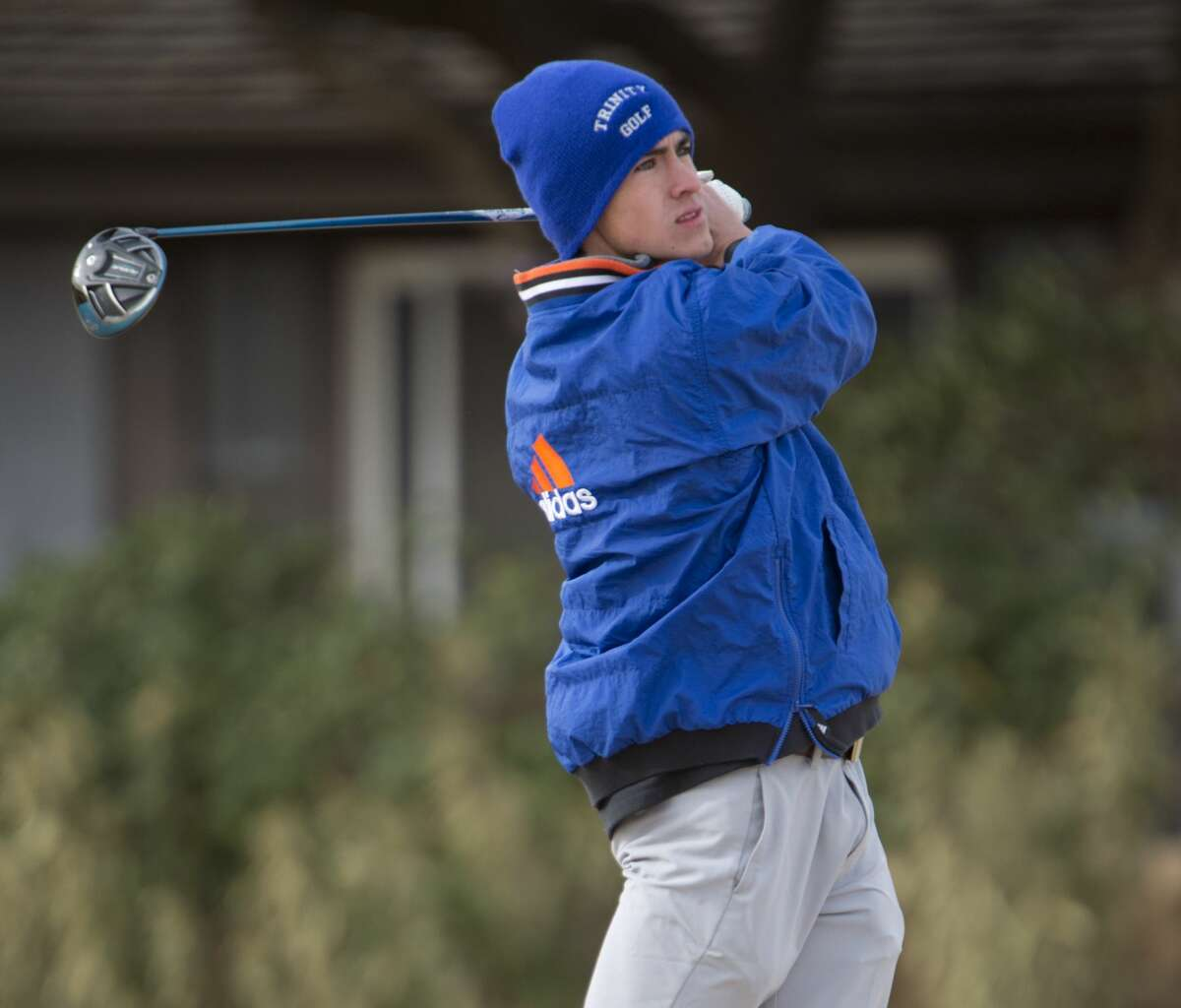 Trinity's Austin Escamilla follows his tee shot 02/16/18 during the Tall City Invitational at Greentree Country Club. Tim Fischer/Reporter-Telegram
