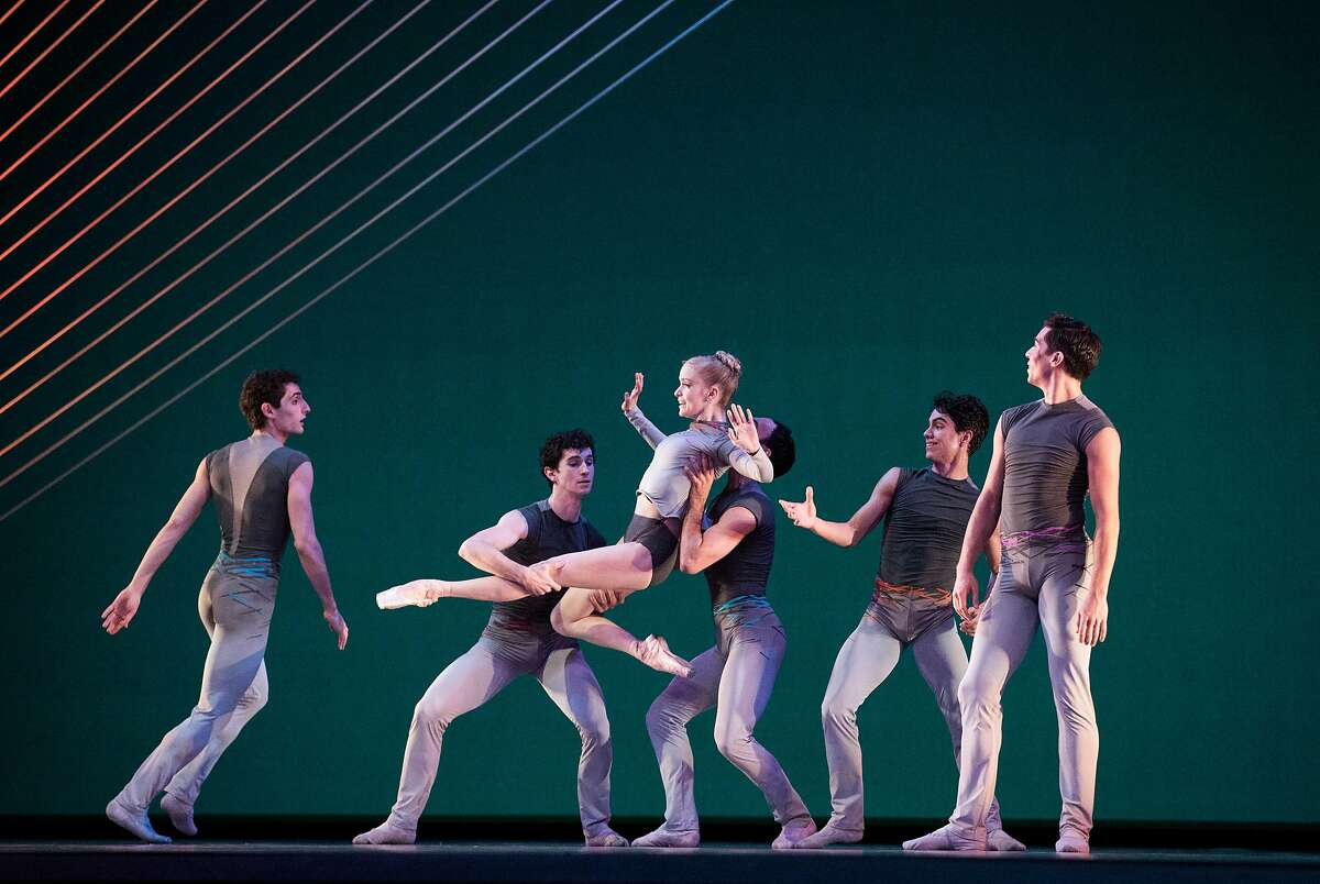 """Principal dancer Sasha De Sola (center) performs """"Ghost In the Machine"""" with other San Francisco Ballet dancers during a dress rehearsal of San Francisco Ballet's Program 3 at War Memorial Opera House in San Francisco, Calif., on Thursday, February 15, 2018. The ballet, choreographed by Myles Thatcher, is one of three ballets in the program, all of which were originally choreographed for the company."""