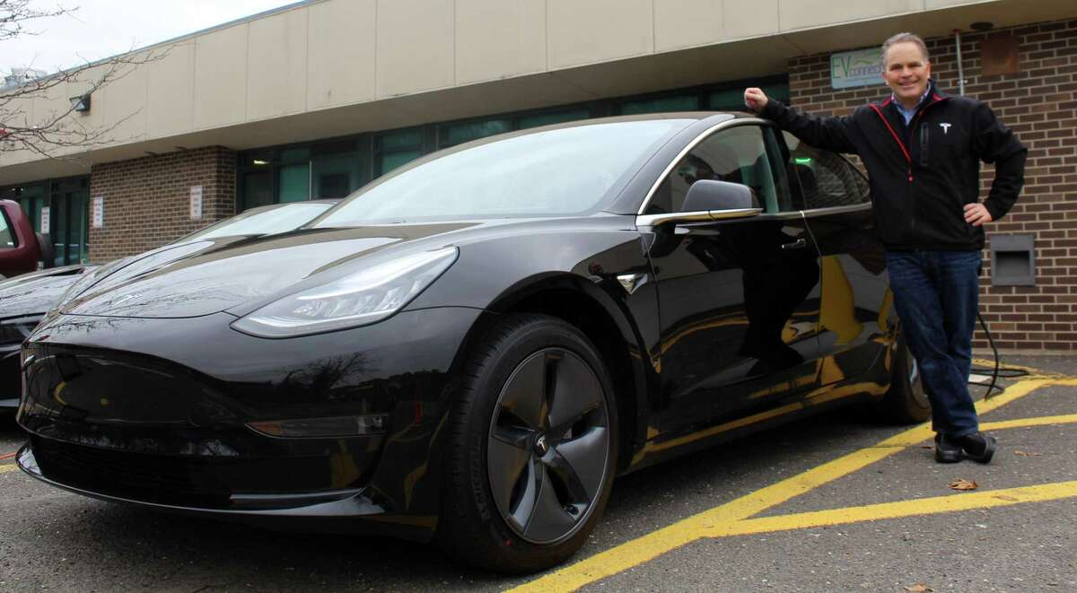 Westport resident Bruce Becker displayed his new Tesla Model 3 vehicle at an event at Staples High School on Feb. 14.