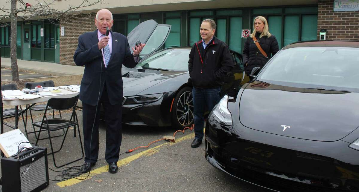 Westport First Selectman Jim Marpe spoke at an event unveiling resident Bruce Becker's new Tesla Model 3 electric vehicle at Staples High School on Feb. 14.