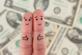 Fingers art of a Happy couple. Man and woman show sign of class on background of money.