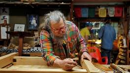 Jay Van Arsdale marks the segments of a platform he's making from western red cedar in his home wood shop in Oakland, Calif., on Wednesday, February 14, 2018. The stands will replace crumbling ones at the Bonsai Garden in Oakland near Lake Merritt. Van Arsdale, who comes from Kentucky and is descended from a long line of blacksmiths dating back to the revolutionary war, is a teacher at Laney Community College in Oakland where he has been teaching Japanese wood working and joinery. He and his students have restored or built various pieces in the Japanese style for cultural centers around the Bay Area.