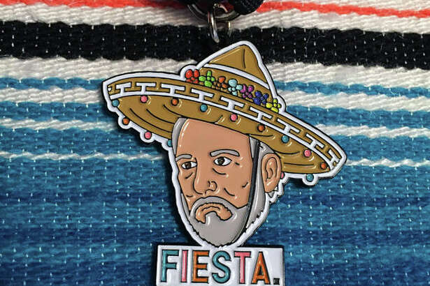 """The latest medal to hit the market is """"Fiesta Coach Popovich,"""" sold by Austin-based designer Name Pinding on Etsy. Matthew Benoit, the creator, said the medal sold out in less than 24 hours and he is working with the manufacturer to restock their inventory."""