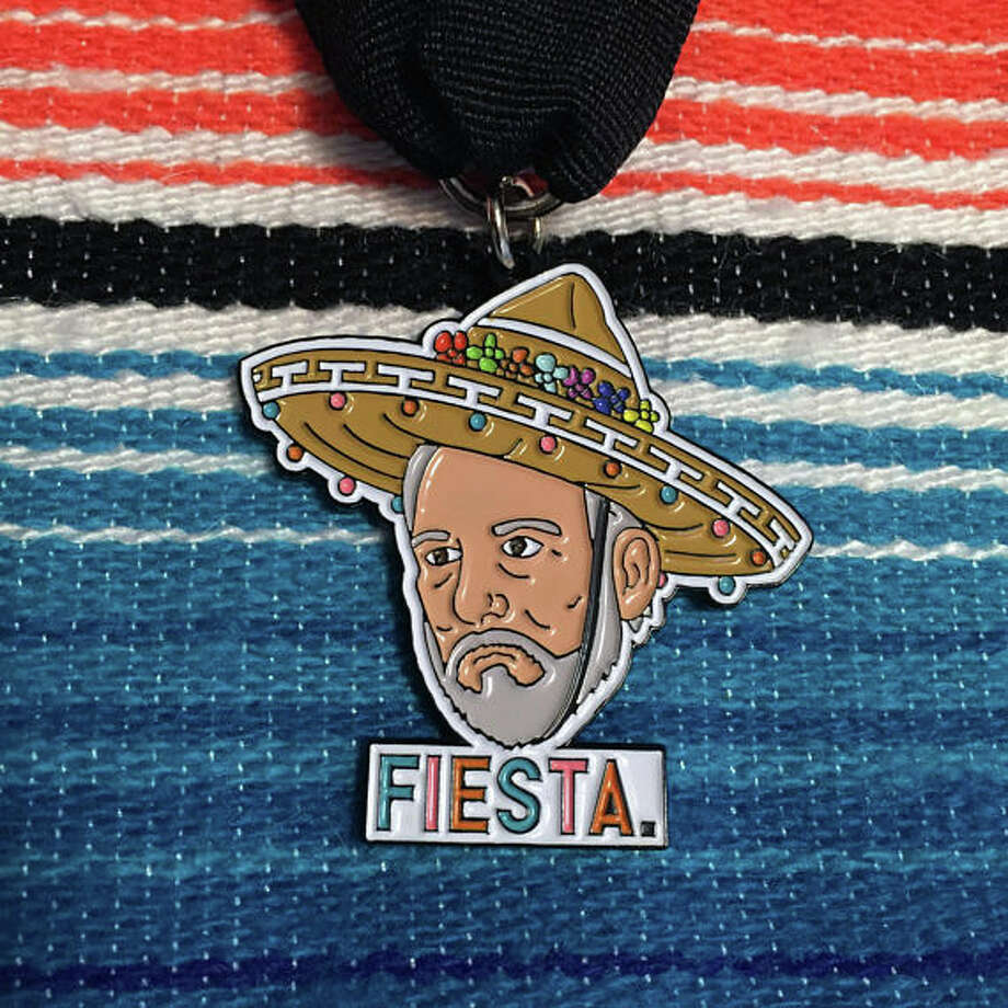 "The latest medal to hit the market is ""Fiesta Coach Popovich,"" sold by Austin-based designer Name Pinding on Etsy. Matthew Benoit, the creator, said the medal sold out in less than 24 hours and he is working with the manufacturer to restock their inventory. Photo: Courtesy, Name Pinding"