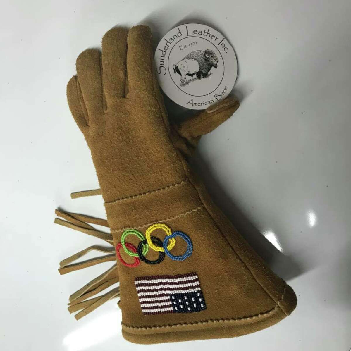 The fringed gloves worn by American athletes at the 2018 Winter Olympic Games in Pyeongchang were made with leather tanned and colored at Sunderland Leather Co., a family-owned leather business in Gloversville.