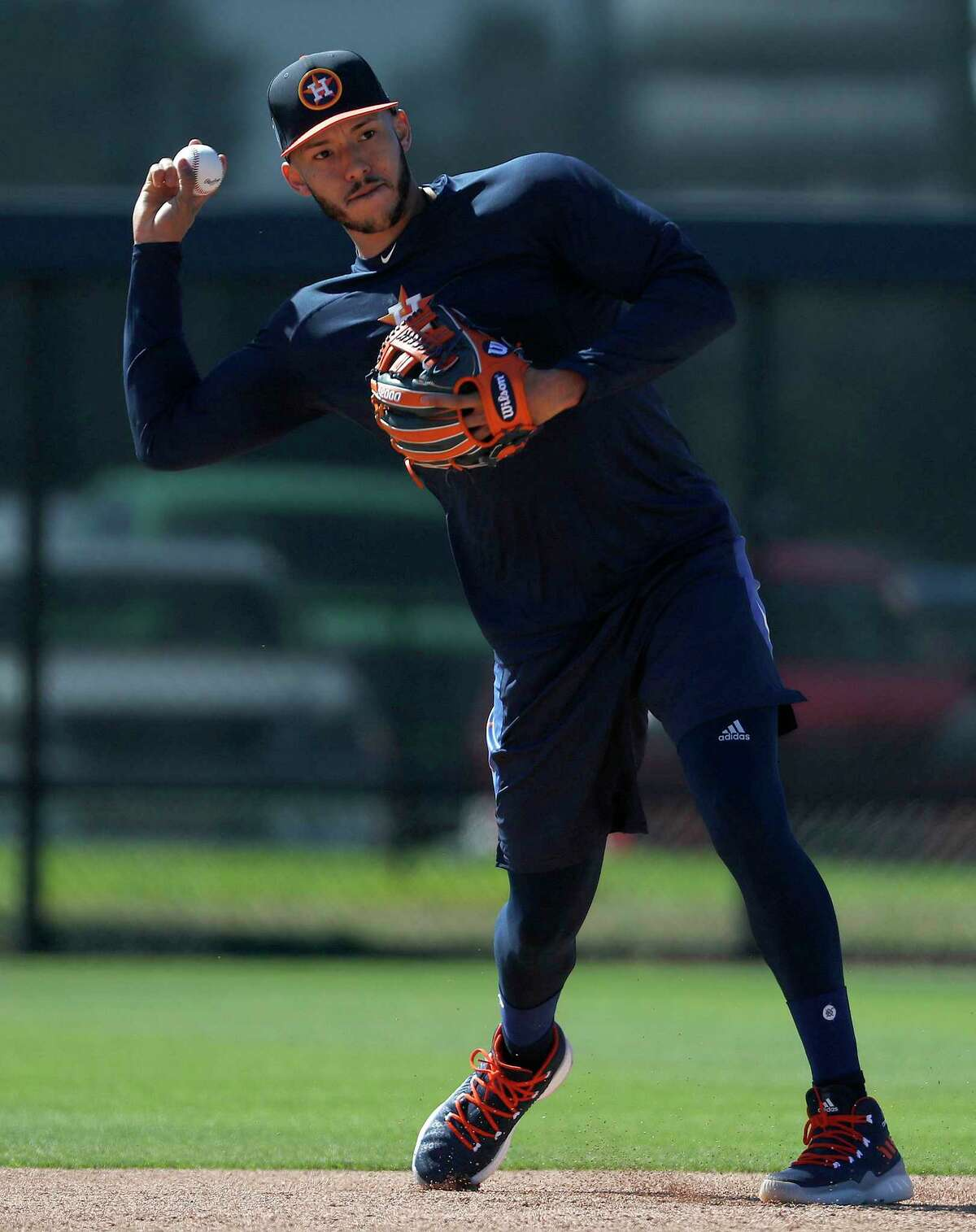 Houston Astros shortstop Carlos Correa throws the ball on a back field as he ran some drills with other early arriving position players during spring training at The Ballpark of the Palm Beaches, Friday, Feb. 16, 2018, in West Palm Beach .